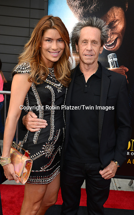 "Brian Grazer and fiancee Veronica Smiley attends the World Premiere of ""Get On Up"" at the Apollo Theater in Harlem in New York Citiy on July 21, 2014."