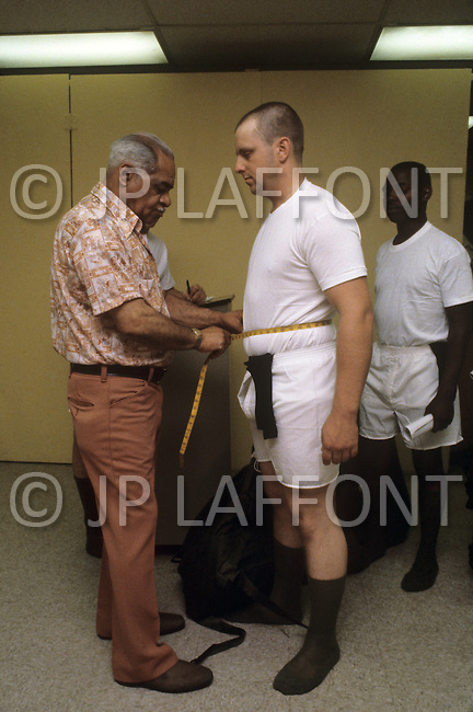 Fort Dix, NJ, USA, June 1980. Recruits are measured before they receive a uniform.
