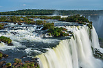 Santa Maria Waterfall at Iguazu Falls National Park in Brazil.  The top of the Devil's Throat Falls with its mist plume is visible above the center of the Santa Maria Falls.  A UNESCO World Heritage Site.