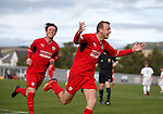 Greig Spence celebrates after scoring from the penalty spot for Raith Rovers chased by Joe Cardle