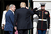 United States President Donald Trump, center, salutes as he walks into the White House with Benjamin Netanyahu, Israel's prime minister, in Washington, D.C., U.S., on Wednesday, Feb. 15, 2017. Netanyahu is trying to recalibrate ties with Israel's top ally after eight years of high-profile clashes with former President Barack Obama, in part over Israel's policies toward the Palestinians. <br /> Credit: Andrew Harrer / Pool via CNP