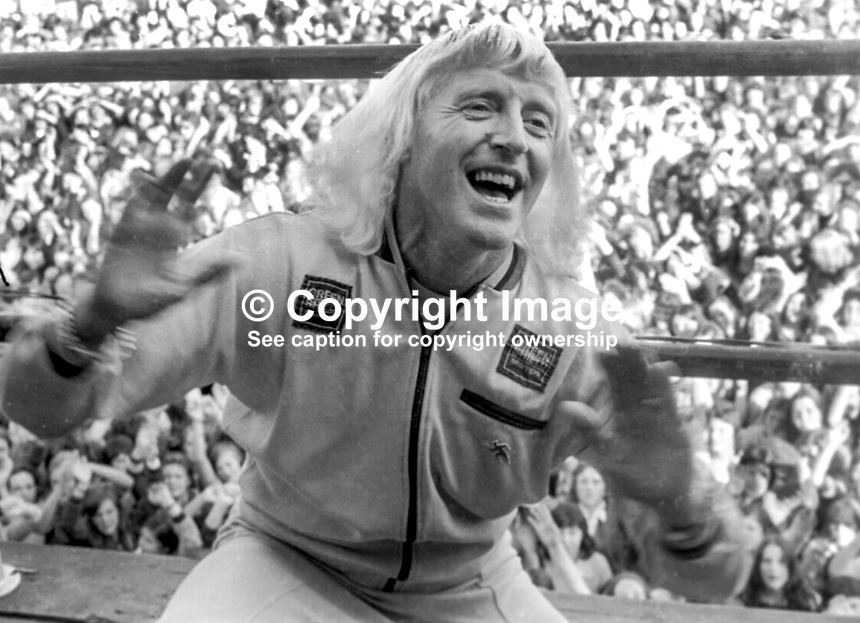 Pop idol, disc jockey, television presenter, Jimmy Savile, UK, performing at Pop Concert, Nutt's Corner, near Belfast, N Ireland, 23rd September 1973. 197309230589b<br />