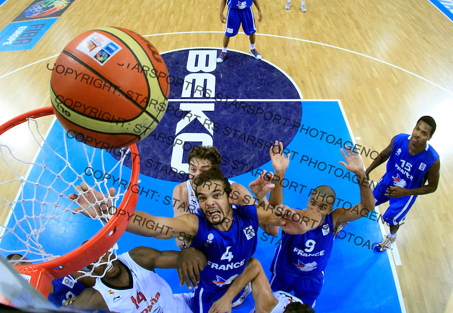 French national basketball team players Noah Joakim and Tony Parker during final Eurobasket 2011 game between Spain and France in Kaunas, Lithuania, Sunday, September 18, 2011. (photo: Pedja Milosavljevic)