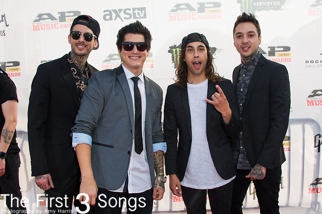 Mike Fuentes, Vic Fuentes, Tony Perry, and Jaime Preciado of Pierce The Vail attend the 2014 AP Music Awards at the Rock And Roll Hall Of Fame and Museum at North Coast Harbor in Cleveland, Ohio.