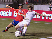 Amy LePeilbet, right, of the United States and Carol Sanchez of Costa Rica battle for the ball during during play in the CONCACAF Olympic Qualifying semifinal match at BC Place in Vancouver, B.C., Canada Friday Jan. 27, 2012. The United States won the match 3-0 to earn a berth in 2012 London Olympics.