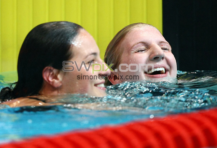 PICTURE BY VAUGHN RIDLEY/SWPIX.COM...Swimming - British Gas Swimming Championships 2011, Day 3 - Manchester Aquatics Centre, Manchester, England - 07/03/11...Keri-Anne Payne (L) and Rebecca Adlington (R) share a laugh after the Womens 200m Freestyle Semifinals.