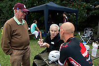 11 AUG 2013 - BIRMINGHAM, GBR - Leo Eason (centre), who won the men's World 10000m title 50 years ago in 1963 and Les Woodley (left), a 12 times British Champion and former World record holder talk about past races with current British 10000m champion Sutton Atkins (right) during the 2013 Federation of Inline Speed Skating British Outdoor Championships at Birmingham Wheels Park, Birmingham, Great Britain (PHOTO COPYRIGHT © 2013 NIGEL FARROW, ALL RIGHTS RESERVED)