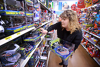 STAFF PHOTO BEN GOFF  @NWABenGoff -- 12/16/14 Shelly Kendrick of Bethel Heights looks at remote-controll helicopters while shopping for Christmas presents for her two nephews in the toy department at the Walmart Supercenter on Pleasant Crossing Boulevard in Rogers on Tuesday Dec. 16, 2014.
