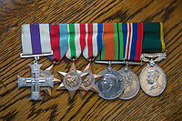 BNPS.co.uk (01202 558833)<br /> Pic: StevePenticost/BNPS<br /> <br /> Jack's medals including his MC won in Sicily.<br /> <br /> A war hero who famously photographed flicking a V-sign at his German captors after being taken prisoner at Battle of Arnhem 75 years ago has died.<br /> <br /> Liuetenant Jack Reynold's plucky act of defiance towards his captors provided one of the most iconic images to come out of doomed Operation Market Garden.<br /> <br /> The officer and his men were overrun by the Germans three days after 10,000 British airborne troops landed behind enemy lines in Holland in the audacious operation.<br /> <br /> As they were being marched away Lt Reynolds spotted a grinning German cameraman shooting video of the vanquished Brits.