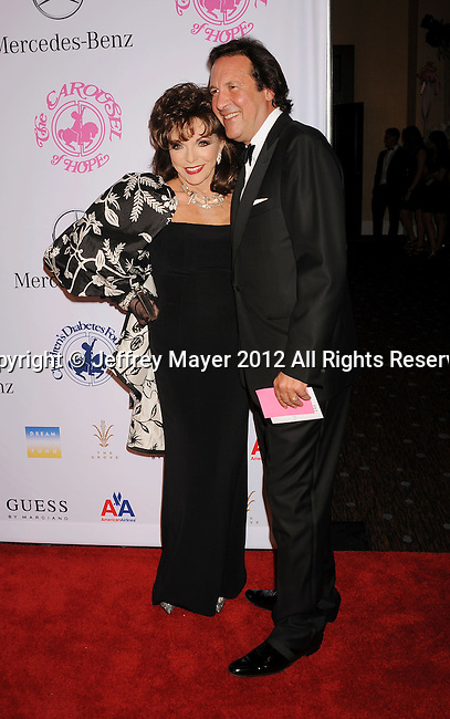 BEVERLY HILLS, CA - OCTOBER 20: Joan Collins and Percy Gibson arrive at the 26th Anniversary Carousel Of Hope Ball presented by Mercedes-Benz at The Beverly Hilton Hotel on October 20, 2012 in Beverly Hills, California.