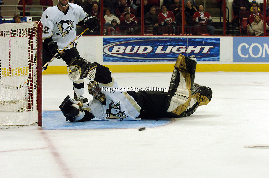 The Pittsburgh Penguins' Sebastien Caron makes a save attempt which ultimately failed against the Carolina Hurricanes in Raleigh, NC Friday, February 10, 2006. The Penguins won the game 4-3...