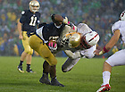 Oct. 13, 2012; Notre Dame running back Theo Riddick is dragged down by Stanford safety Jordan Richards during the fourth quarter at Notre Dame Stadium. Photo by Barbara Johnston/University of Notre Dame