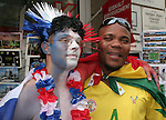 23 June 2006: A France fan with a Togo fan. Togo played France at the RheinEnergie Stadion in Cologne, Germany in match 45, a Group G first round game, of the 2006 FIFA World Cup.