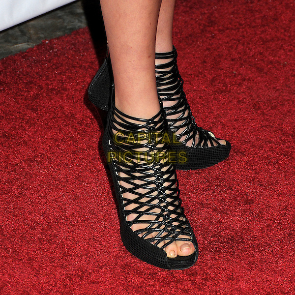 AMANDA CREW's shoes.Nylon Magazine's Young Hollywood Party held at the Roosevelt Hotel's Tropicana Bar, Hollywood, California, USA..May 12th, 2010.feet heels ankle boots sandals strappy black .CAP/ADM/BP.©Byron Purvis/AdMedia/Capital Pictures.