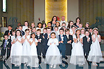 4767-4771.---------.Communion.---------.Student's from Gaelscoil Mhic Easmainn, Killeen Rd, Tralee who received their 1st Holy Communion last Saturday morning at St Brendan's church,Tralee with Fr Gerard Finucane their teachers are Treasa Ui? Raghaill and Olive Ui? Ghe?ara?in.