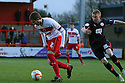Robin Shroot of Stevenage escapes from Nicky Adams of Crawley. Stevenage v Crawley Town - npower League 1 -  Lamex Stadium, Stevenage - 15th December, 2012. © Kevin Coleman 2012..