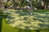 Danyaal Waheed '18, left, and Cam Conner '17 use the new putting green on the Occidental College campus on March 26, 2015. The outdoor facility may be called: Andrew E. Rubin Practice Facility, including the Pongracz and Wright Families Putting Green & Tiger Golf Hitting Bays.<br /> (Photo by Marc Campos, Occidental College Photographer)