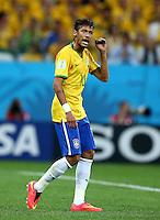 Neymar of Brazil waves to a team mate