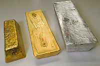 The second melting of a raw gold  and silver  bar to get a more refined product suitable for export, Medellin, Colombia