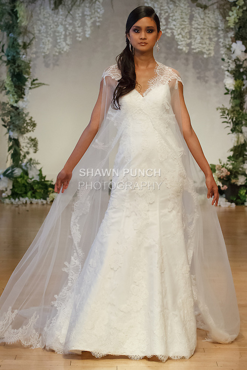 "Model walks runway in a bridal gown from the Sarah Jassir 2017 ""The Secret Garden"" collection on October 8th 2016, during New York Bridal Fashion Week."