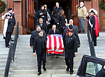 "WATERBURY CT. 31 December 2018-123118SV01-Family and friends follow pallbearers as the carry Zeqir ""Ziggy the Flag Man"" Berisha out of St. Francis Xavier Church during his funeral in Waterbury Monday. <br /> Steven Valenti Republican-American"