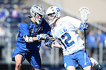 08 February 2015: Duke's Seamus Connelly (12) pushes past Air Force's Joe Matarazzo (left). The Duke University Blue Devils hosted the United States Air Force Academy Falcons at Koskinen Stadium in Durham, North Carolina in a 2015 NCAA Division I Men's Lacrosse match. Duke won the game 13-7.