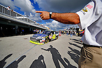 Nov. 15, 2008; Homestead, FL, USA; NASCAR Sprint Cup Series driver Jimmie Johnson is directed out of the garage by an official during practice for the Ford 400 at Homestead Miami Speedway. Mandatory Credit: Mark J. Rebilas-