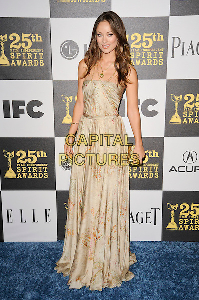 OLIVIA WILDE.The 25th Annual Film Independent Spirit Awards at the LA Live Event Deck in Los Angeles, California, USA..March 5th, 2010  .full length strapless beige gold print printed patterned pattern dress necklace clutch bag maxi .CAP/ROT.©Lee Roth/Capital Pictures
