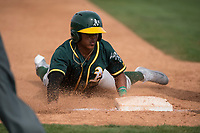 Oakland Athletics shortstop Brallan Perez (28) slides into third base during a Minor League Spring Training game against the Chicago Cubs at Sloan Park on March 13, 2018 in Mesa, Arizona. (Zachary Lucy/Four Seam Images)
