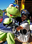 "12 July 2007: Vermont Lake Monsters catcher Sean Rooney fools around with mascot ""Champ"" prior to a game against the Mahoning Valley Scrappers at Historic Centennial Field in Burlington, Vermont. The Scrappers defeated the Lake Monsters 11-2 in the first game of their NY Penn-League double-header...Mandatory Photo Credit: Ed Wolfstein Photo"