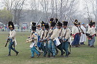 People in period military uniforms re-enact a historic battle in Tapiobicske (about 60 kilometres East-Southeast of capital city Budapest), Hungary on April 4, 2019. ATTILA VOLGYI