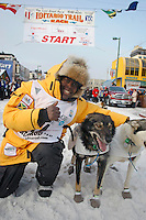 Saturday March 6 , 2010  Jamaican musher Newton Marshall with his lead dogs at the start line of the ceremonial start of the 2010 Iditarod in Anchorage , Alaska