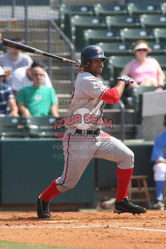 Edgardo Baez of the Potomac Nationals swinging the bat versus the Myrtle Beach Pelicans at BB&T Coastal Field in Myrtle Beach, SC on May 7, 2008