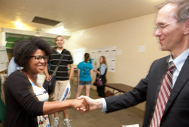 Aisha Upton is congratulated by Joseph Shields at the Student Expo