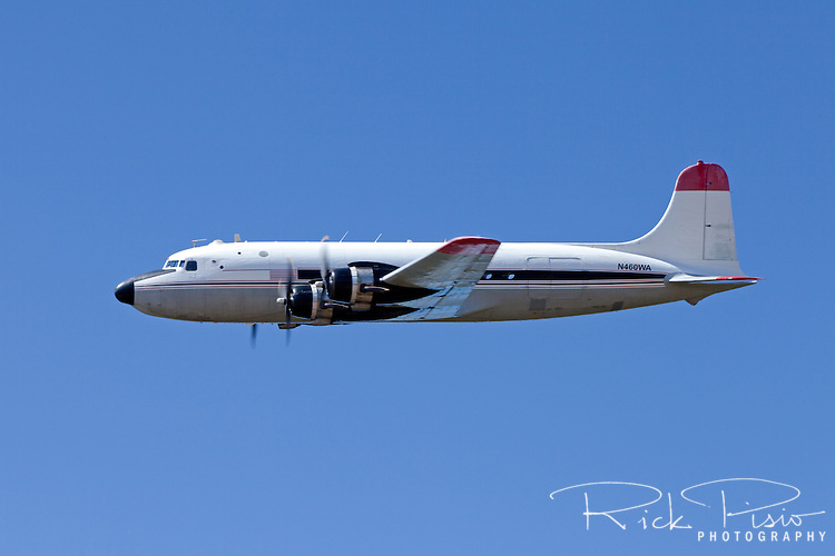 DC4, 460WA,owned by Florida Air Transport and currently flying out of the now retired Castle Air Force Base in Atwater, CA, in flight over Nevada County Airport in July of 2013.