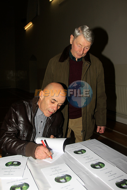 Brendan Matthews &amp; Michael Murphy during the Launch of Battle of Julianstown &amp; the Siege of Drogheda Book at Julianstown Community Centre on Saturday 22nd November 2014.<br /> Picture:  Thos Caffrey / www.newsfile.ie