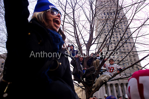 New York, New York<br /> February 7, 2012<br /> <br /> Crowds watch the New York Giants victory Super Bowl parade, after defeating the  New England Patriots, as it moves down Lafayette Street  at Foley Square. Quarterback Eli Manning holds up the Vince Lombardi Trophy as his float passes by.New York, New York.February 7, 2012..Parade for the New York Giants who won the Super Bowl on Sunday against the New England Patriots.
