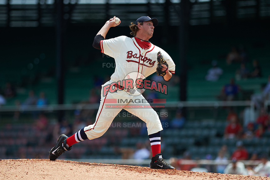 Birmingham Barons pitcher Kyle Hansen (33) delivers a pitch during the 20th Annual Rickwood Classic Game against the Jacksonville Suns on May 27, 2015 at Rickwood Field in Birmingham, Alabama.  Jacksonville defeated Birmingham by the score of 8-2 at the countries oldest ballpark, Rickwood opened in 1910 and has been most notably the home of the Birmingham Barons of the Southern League and Birmingham Black Barons of the Negro League.  (Mike Janes/Four Seam Images)