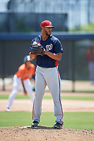 GCL Nationals starting pitcher Joe Ross gets ready to deliver a pitch during a game against the GCL Astros on August 6, 2018 at FITTEAM Ballpark of the Palm Beaches in West Palm Beach, Florida.  GCL Astros defeated GCL Nationals 3-0.  (Mike Janes/Four Seam Images)