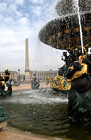 Fountains  with the obelisk of Ramises II in the background of the Palace de la Concorde. Paris, France.
