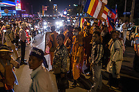 December 09, 2013 - Phnom Penh, Cambodia. Monks and activists block a main road after being barred access to a pagoda at the end of a 10 day Human Rights march through the country. © Nicolas Axelrod / Ruom