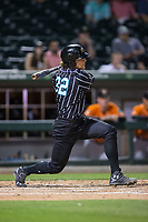 Kevan Smith (32) of the Charlotte Knights follows through on his swing against the Norfolk Tides at BB&T BallPark on May 2, 2017 in Charlotte, North Carolina.  The Knights defeated the Tides 8-3.  (Brian Westerholt/Four Seam Images)