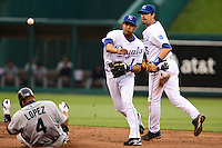 Royals shortstop Tony Pena turns a double play as Mariners Jose Lopez slides into second and Mark Grudzielanek looks on during the third inning at Kauffman Stadium in Kansas City, Missouri on May 26, 2007. Seattle won 9-1.
