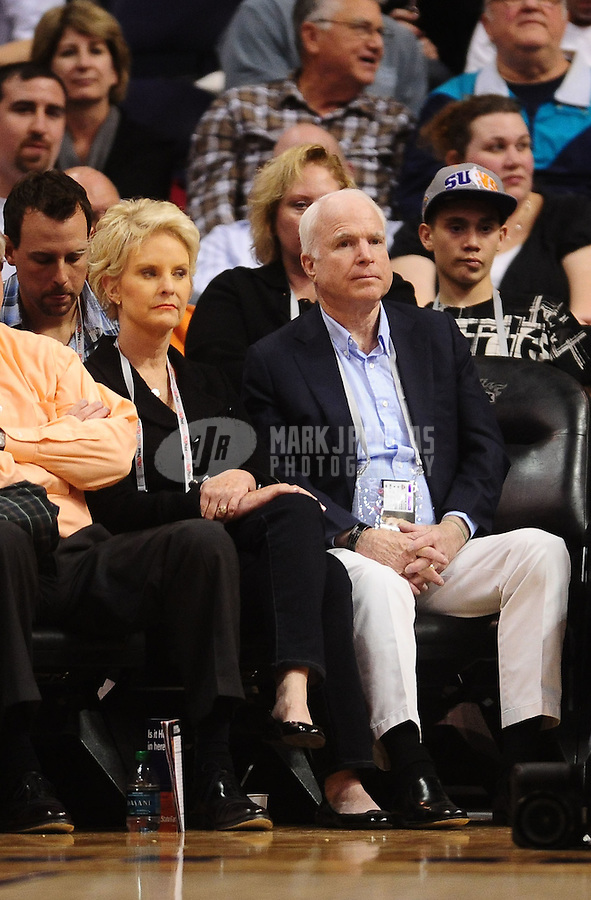 Jan. 14, 2011; Phoenix, AZ, USA; Arizona senator John McCain (right) sits court side with wife Cindy McCain during the game between the Phoenix Suns against the Portland Trailblazers at the US Airways Center. The Suns defeated the Trailblazers 115-111. Mandatory Credit: Mark J. Rebilas-