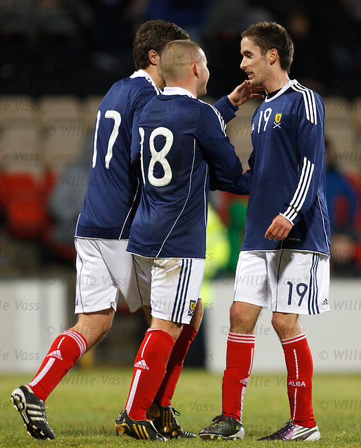 Nick Ross scores the third goal for Scotland and takes the acclaim