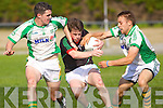 Shane Murphy Milltown-Castlemaine in action against Brian Costello and Eoin Murray Saint Brendans in the First Round of the Kerry Senior Football Championship at Milltown on Sunday.