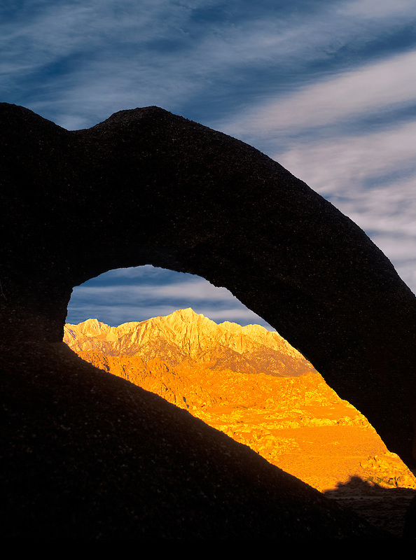 Lone Pine Peak as seen through silhouetted arch. Alabama Hills, California.