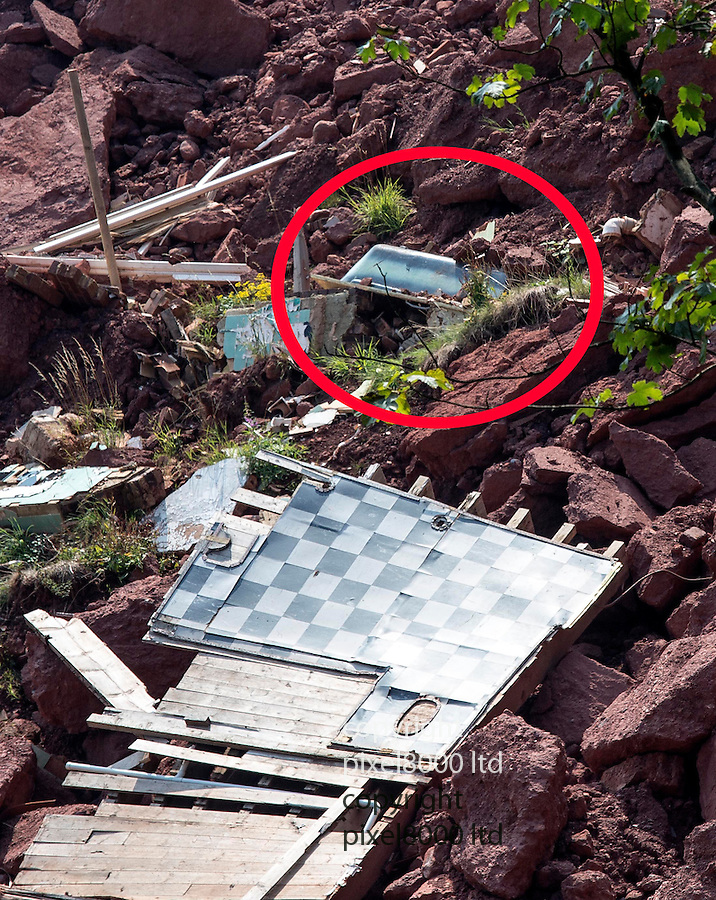 House near Torquay falling into the sea becomes tourist attraction.<br /> <br /> Pic shows: Ridgemont House bathroom floor and bath is now a hundred foot down the cliff<br /> <br /> Ridgemont House, on Redcliffe Road became famous when a woman bought it at auction sight unseen for 189,000 pounds.<br /> It was unstable and now half has fallen 150 feet onto the beach and sea below.<br /> Local hotel and B&amp;B owners suggest the sight as a tourist attraction and many people go for a look.<br /> <br /> <br /> <br /> <br /> Pic by Gavin Rodgers/Pixel 8000 Ltd
