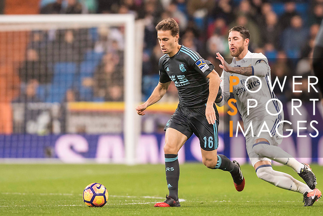 Sergio Canales Madrazo (l) of Real Sociedad fights for the ball with Sergio Ramos of Real Madrid during their La Liga match between Real Madrid and Real Sociedad at the Santiago Bernabeu Stadium on 29 January 2017 in Madrid, Spain. Photo by Diego Gonzalez Souto / Power Sport Images