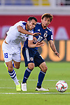 Takashi Inui of Japan (R) competes for the ball with Fozil Musaev of Uzbekistan (L) during the AFC Asian Cup UAE 2019 Group F match between Japan (JPN) and Uzbekistan (UZB) at Khalifa Bin Zayed Stadium on 17 January 2019 in Al Ain, United Arab Emirates. Photo by Marcio Rodrigo Machado / Power Sport Images